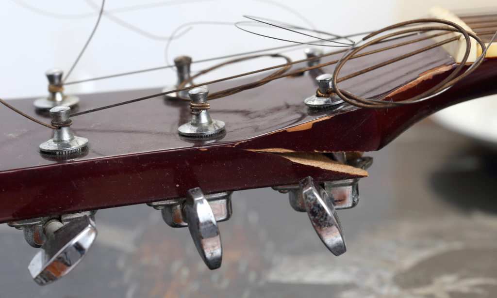 Very dilapidated old guitar